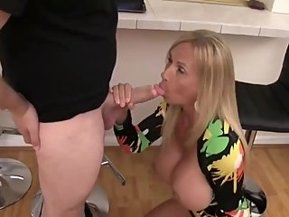 Sexy and busty MILF sucks her best friend's cock like a master