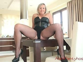 Blonde MILF in Fishnet pantyhose and high heels