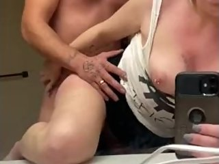 Bent over and fucked in the bathroom - skirt up natural tits out