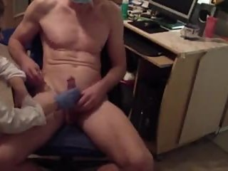 Russian lady doctor does an special handjob exam to her submissive client