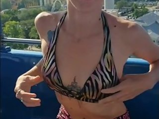 Hot MILF Shows off Her Boobs at Public Amusement Park (Quick tit Flashes)
