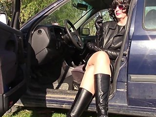 Smoking cigarettes in leather gloves and leather outfit