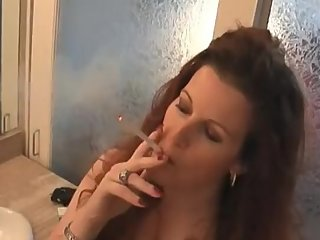 The incredibly smoking hot redhead milf Vivian smoking oh so sexy!