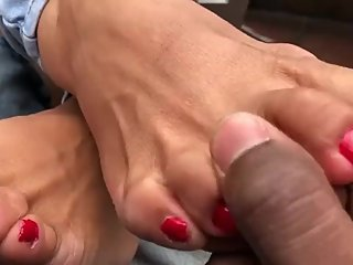 Mexican lady using her feet to make dick stiff in public