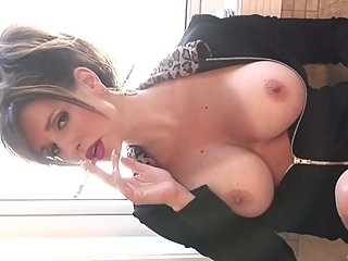 Smoking hot brunette milf blowing oh so hot smoke while topless!