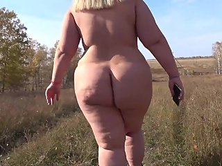 fully naked bbw with a big ass, walks outdoors